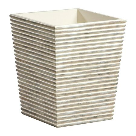 Bring Scandinavian style to your powder room or master bath with this lovely wood waste basket, featuring a cream finish and grooved exterior....
