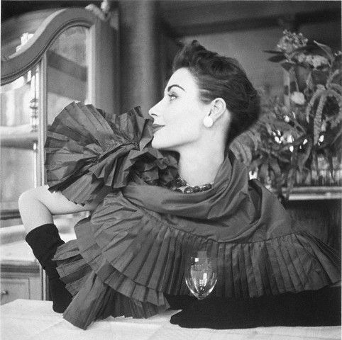 Model wearing taffeta pleated shawl by Dior. Photographed by Robert Randall, 1952.