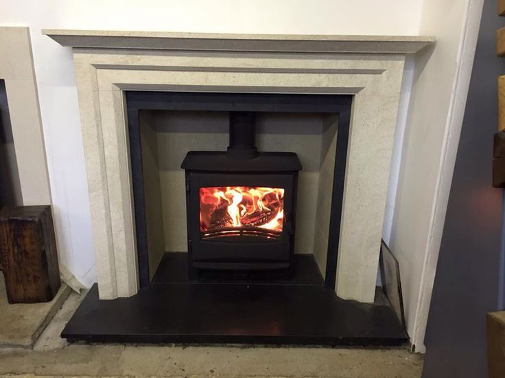 The Broseley Ignite 7 multifuel stove set in a Loja fireplace.