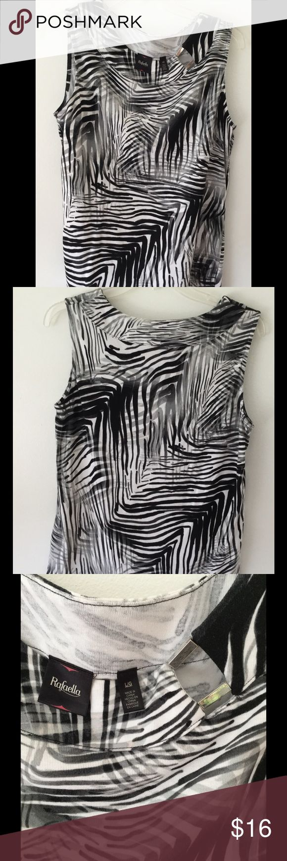 Rafaella black & white sleeveless top size large Price reduced! Beautiful black and white Rafaela sleeveless shirt with metal accent at neckline (shown in last picture). Size large. 100% cotton. Like new. Only wore 2/3 times. Pair with black leggings or shorts for a classic look. Very comfortable and cool for hot summer days. Runs slightly small. Rafaella Tops