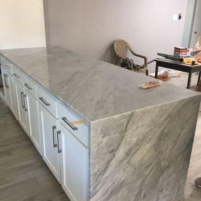 Waterfall Carrara Marble Kitchen Countertop Econ Granite Dallas Tx 2144340974 Econgranite Countertops Quartzite Table