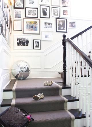 Grey carpet runner with lighter border...pops on the dark stained stairs. Gallery wall is a bonus!