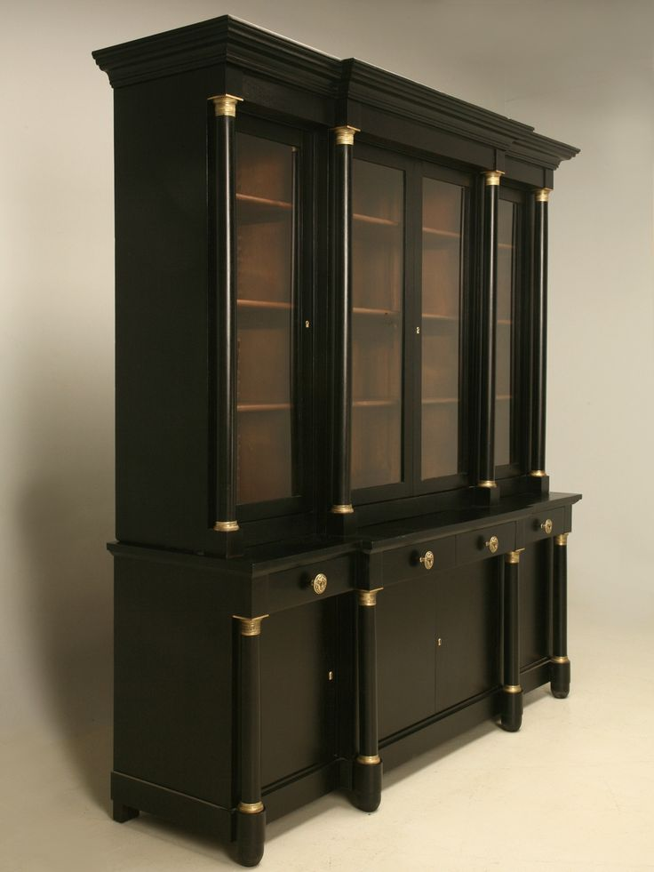 French Empire Style Bookcase with an Ebonized Magohany Finish | From a unique collection of antique and modern bookcases at https://www.1stdibs.com/furniture/storage-case-pieces/bookcases/
