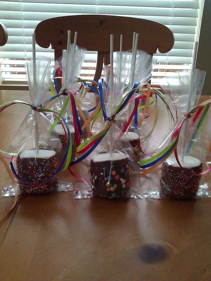 These are GIANT marshmellows that I dipped in chocolate and covered with sprinkles. Great kids party favor...or any kind of party treat.