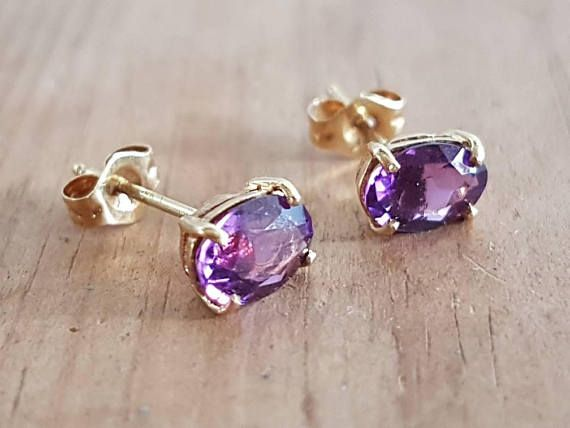 Check out this item in my Etsy shop https://www.etsy.com/au/listing/552915610/vintage-14ct-gold-amethyst-stud-earrings