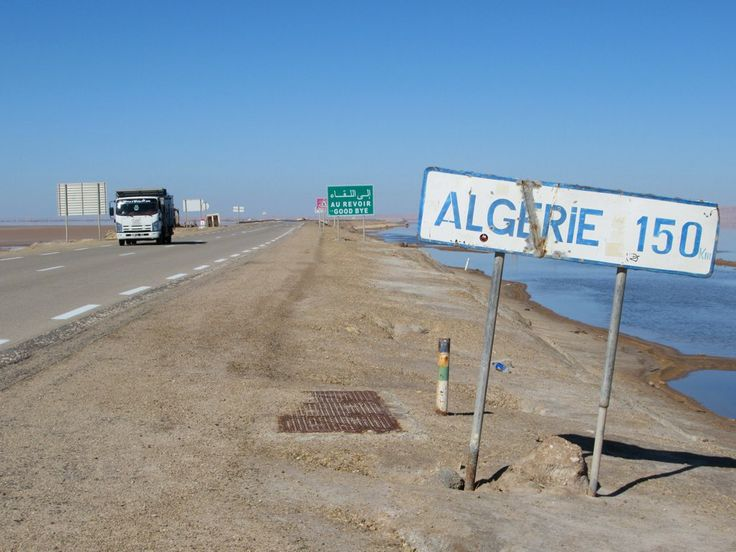 A signpost next to the Chott El Djerid salt lake in southern Tunisia notes that Algeria is only 150 kilometers away.