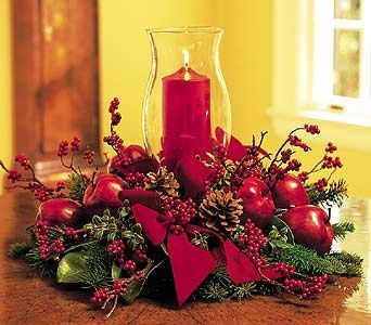""""""" BEAUTIFUL HURRICANE PILLAR"""" -  What better way to light up wintry hearts than with a gorgeous candle set in a hurricane globe? A decorator's delight.  Douglas fir, oregonia, pinecones, apples and berries decorate a red pillar candle inside of a 12"""" hurricane globe."""