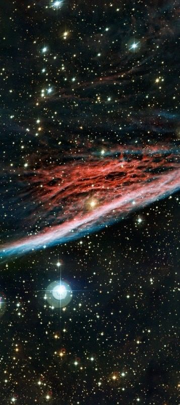 #PencilNebula | This shock wave plows through space at over 500,000 kilometers per hour. Moving toward to bottom of this beautifully detailed color composite, the thin, braided filaments are actually long ripples in a sheet of glowing gas seen almost edge on. About 5 light-years long and a mere 800 light-years away, the Pencil Nebula is only a small part of the #VelaSupernovaRemnant.