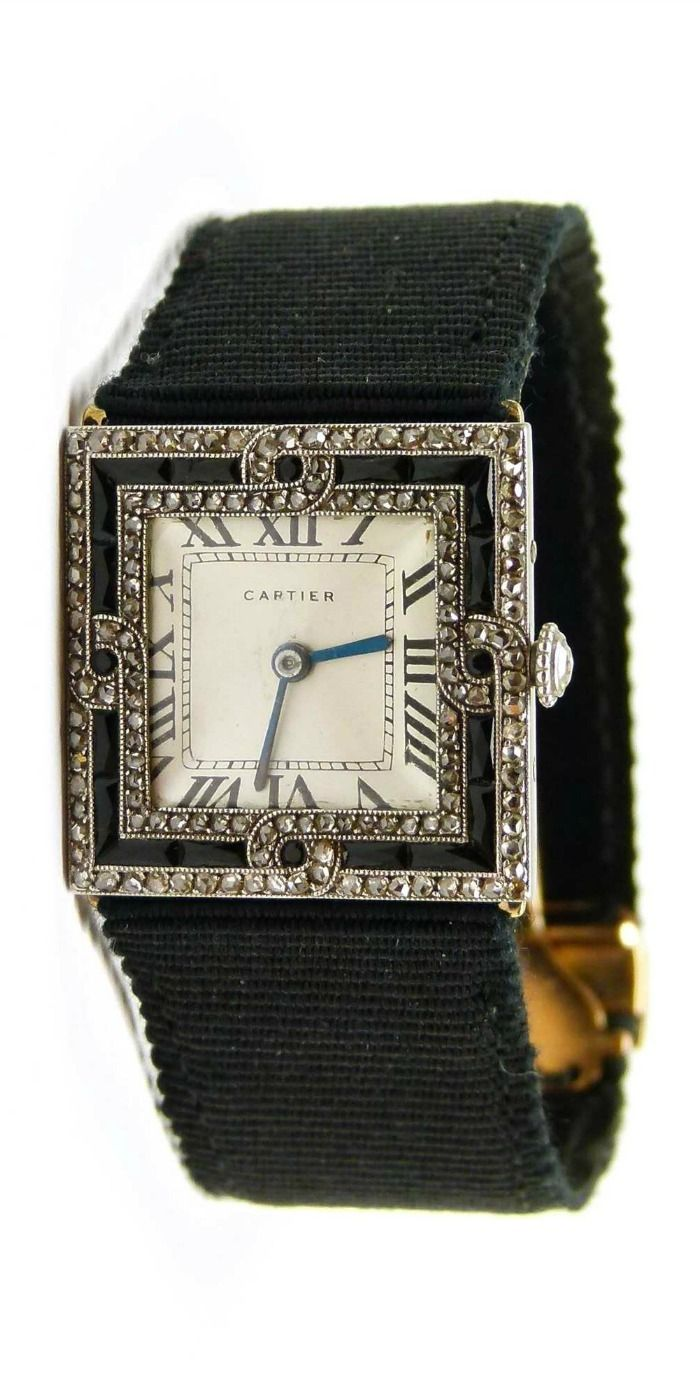 Art Deco diamond and onyx square shaped lady's wristwatch by Cartier, Paris c.1920, the white dial with black Roman numerals and blued steel hands, triple line onyx and diamond set bezel incorporating a diamond scroll to each side, platinum and gold cased, on a gold and platinum deployant clasp with onyx and diamond set rectangle fastener, case numbered 249 and another number partially rubbed.  At SJ Phillips.