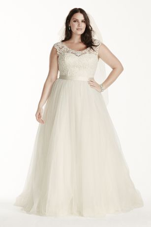 The path to true love follows a unique pattern all its own, much like this oh-so-pretty tulle ball gown. The scroll lace that adorns the bodice creates an elegant pattern that partners beautifully with the illusion cap sleeves. A flattering satin waistband completes the look.
