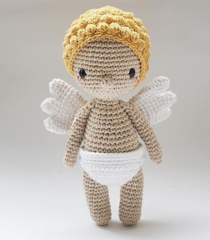 """{This little angel is called Fynn and he wants to participate in the """"Fantastic Creatures"""" Design Contest organized by @amigurumipatterns. I told him he could not since guardian angels are not fantastic creatures but REAL beings! Anyway, he wasn't happy with my answer so I must come up with a nice costume that would allow him to enter the contest... I am thinking something with a shiny horn: l'll keep you posted...}"""