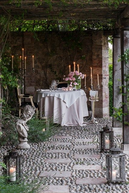 Outdoor dining in the courtyard garden at Borgo Santo Pietro hotel in Italy | The top 10 most beautiful boltholes to get swept away to, from the Amalfi Coast to Venice