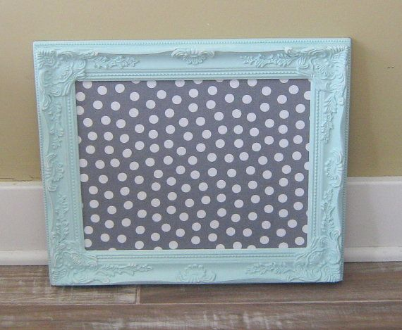 a shabby chic ornate framed pin board it has been painted a mint green shade