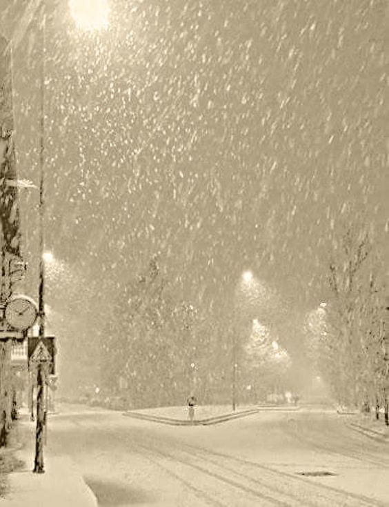 Watching the snow fall while looking through a window in a cozy, warm room, gives me such a sense of serenity... all's right with the world!