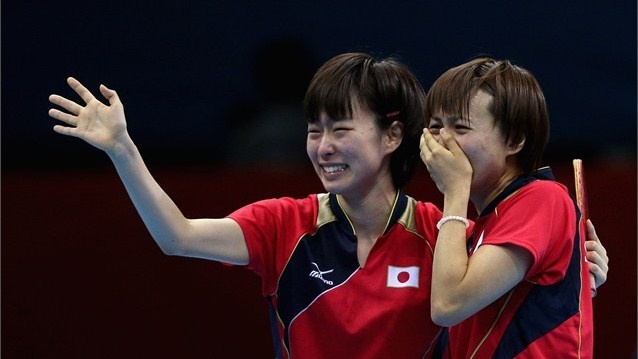 Kasumi Ishikawa and Sayaka Hirano of Japan celebrates during Women's Team Table Tennis semifinal match against team of Singapore on Day 9.