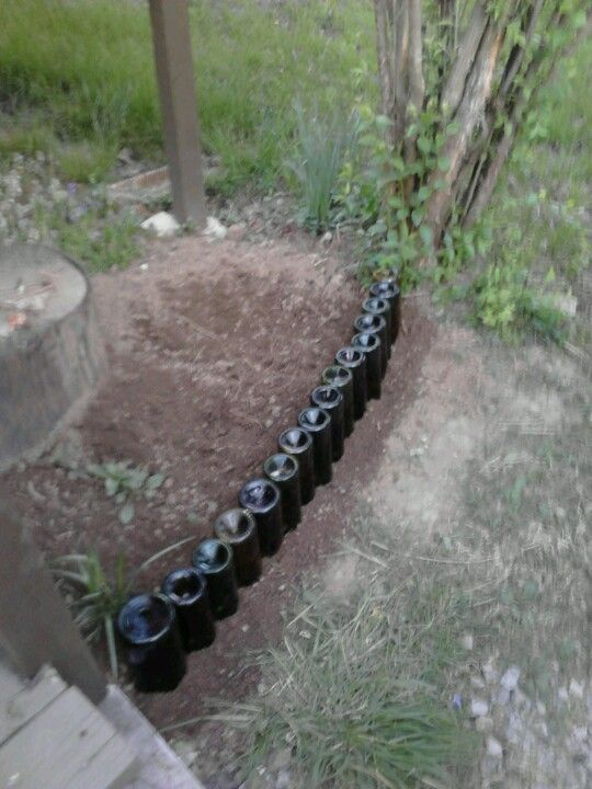 I recycled wine bottles into a fence for my flower bed!
