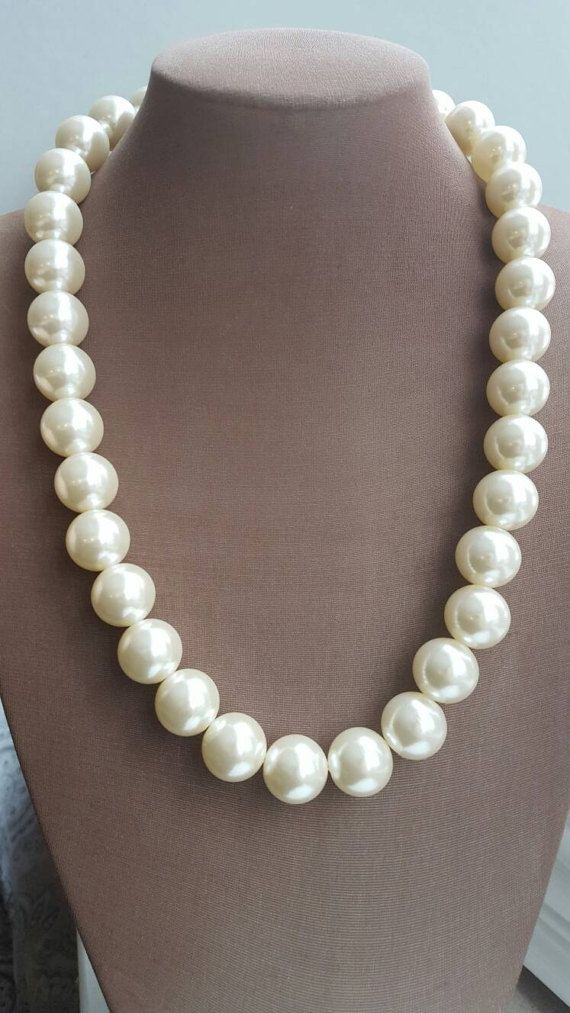 Check out this item in my Etsy shop https://www.etsy.com/ca/listing/496646276/chunky-pearl-necklacelong-pearl-bridal