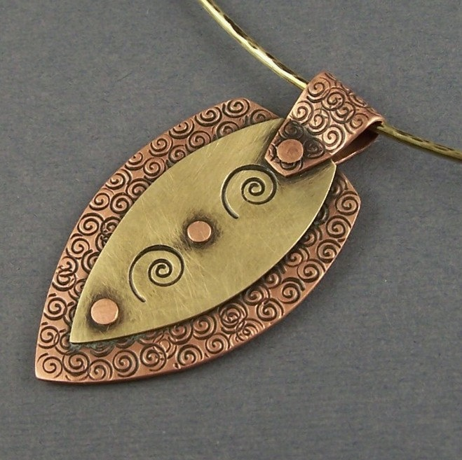 Copper and Brass Mixed Metal Modern Shield Pendant. $69.00, via Etsy.