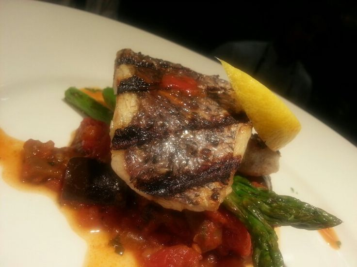 Grilled barramundi served with sicilian caponata & asparagus