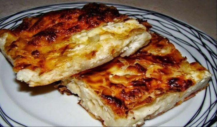 Υλικά   1 πακέτο φύλλο κρούστας  6 αυγά  400γρ κρέμα γάλακτος  500-600γρ τυριά τριμμένα  700ml γάλα  Φρεσκοτριμμένο πιπέρι  Λίγο σκόρ...