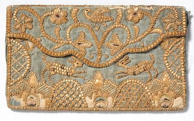 This final lot 1130 with an estimate of £200-£300 is an early 19th Century straw work letter case designed in an envelope style with a blue silk ground embroidered with straw work and silk threads, depicting foliate motifs, dogs, birds, coronet and two entwined love hearts
