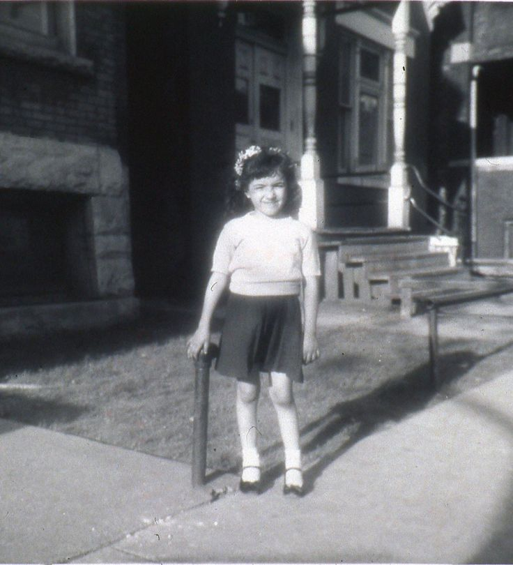 Sandra Cisneros as a child in front of the house that inspired 'The House on Mango Street.'