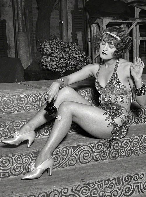 Washington, D.C., 1926. Chorus girl using electric massage vibrator.