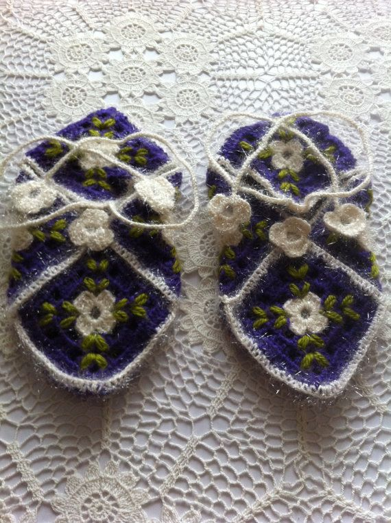 "Purple crochet slippers with a white centre and green embroidery. There is a long crochet cord which ties around your leg made from a fuzzy type of yarn.    8"" length (20cm)  4"" width (10cm)    Stretchy and will fit most medium sized feet. $15AUD"