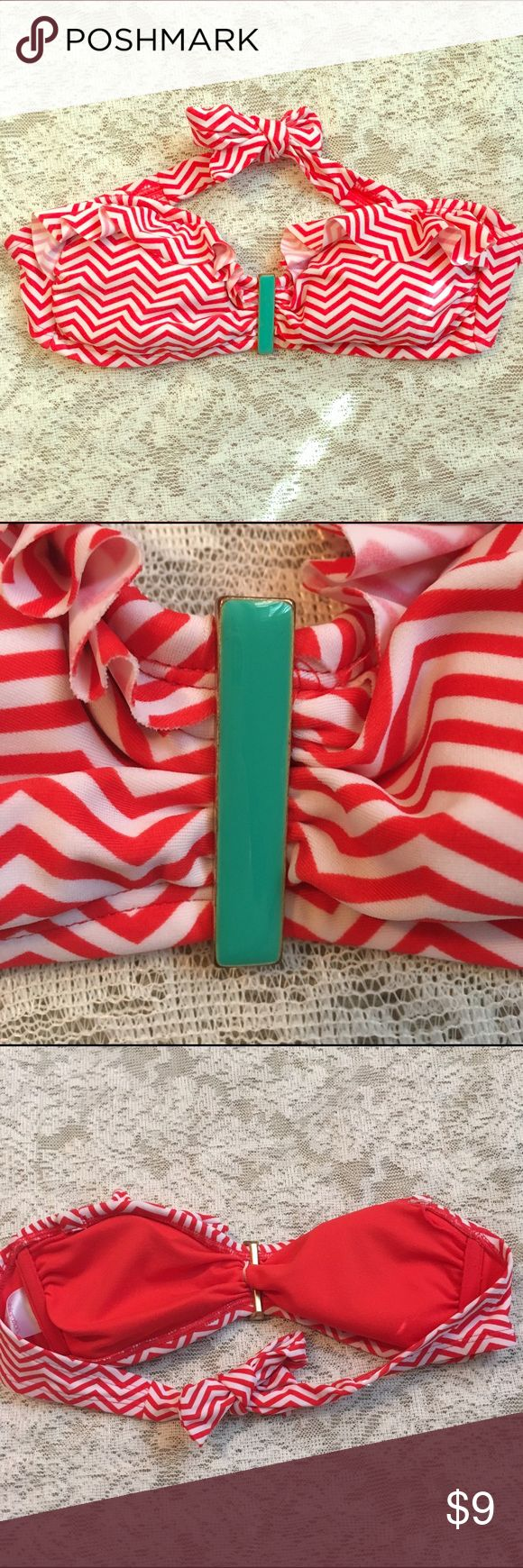 Xhilaration chevron bandeau bikini top Super cute for summer, this ruffled bandeau top has a chevron pattern, with a teal/gold metal bar in the middle that adds a fun pop of color. Tie back. No pilling or flaws! Color is an orangey red Xhilaration Swim Bikinis
