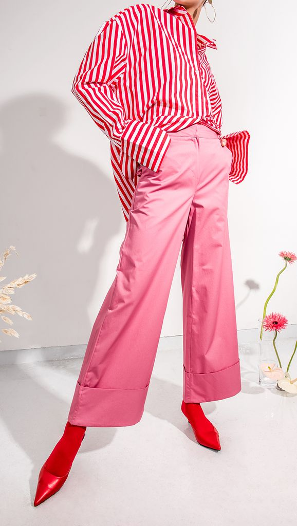 The Marcelle Pant in pink. Wide trouser with folded hem and concealed hook and eye zip closure at front. Loose fit. COMPOSITION AND CARE Dry Clean Do not bleach or tumble dry Please treat with care to
