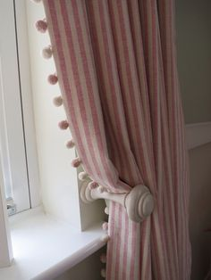 Striped curtains with pom pom trim A pair of full length pencil pleat curtains with a pom pom trim leading edge. Ivory curtain pole and matching holdbacks. Fabric and trim by Susie Watson.  Poles and holdbacks supplied by LJ Curtains.