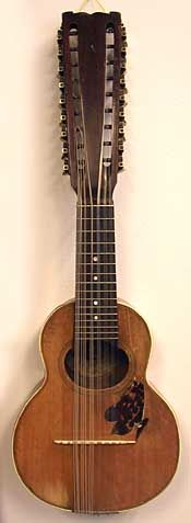A strange, 18-string (6 triple courses) Lyric brand bandurria-like instrument built by The Schireson Bros. ca. 1911-1920s. From the collection of Gary Schireson.