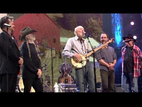 Pete Seeger performs 'This Land is Your Land' with Farm Aid board artists John Mellencamp, Willie Nelson, Dave Matthews and Neil Young live at the Farm Aid concert in Saratoga Springs, NY on September 21, 2013. At 02:30 he sings a new verse he has written to call for a frack free New York. Published on youtube.com on 21 September 2013