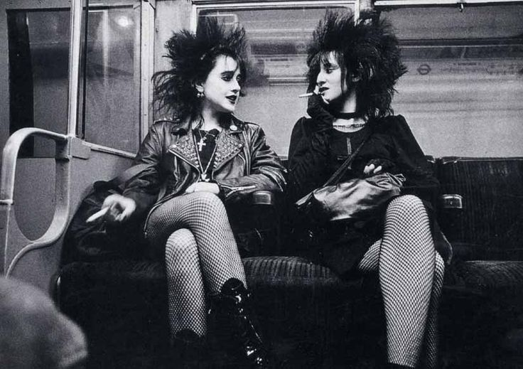 Punk Style  Late 1970's  The punk style originated in London. THey wore ripped clothing, exagerated hairstyles, mini skirts, fishnet stockings, safety pins and big makeup.  Found at: