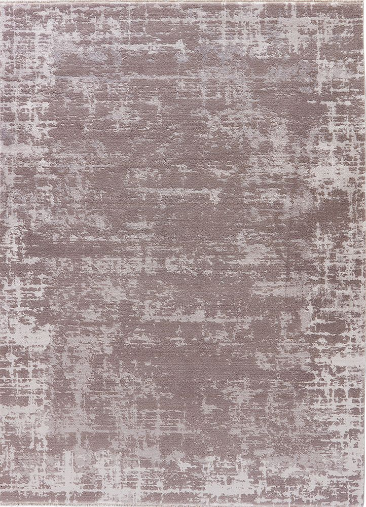 Pelle From The New Denisili Collection Of Machine Made Rugs Reflects A Chic Abstract Pattern In Sophisticated Shades Moonbeam And Flint Gray
