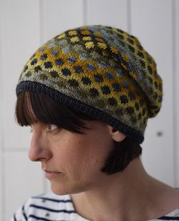 Sonia hat by Anna Elliott. Play with shades and contrasts of colour to create your own unique version of this slouchy beanie hat, using stranded colourwork and sock yarn mini skeins.