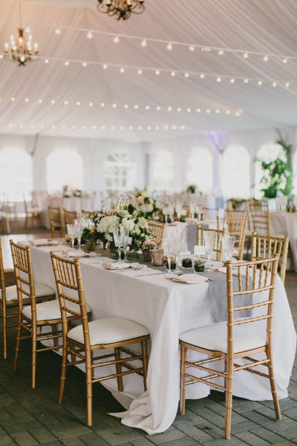 Cozy tented reception with pretty string lights: http://www.stylemepretty.com/vermont-weddings/quechee-vermont/2016/04/27/this-is-how-a-chic-new-york-couple-gets-married-in-rustic-vermont/ | Photography: Emily Delamater - http://emilydelamaterphotography.com/