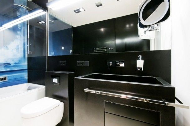 Apartment - Excellent Details Of Dark Vanity And Sink At White Water Apartment Bathroom With Chrome Towel Bar And Backlit Mirror: Stylish an...
