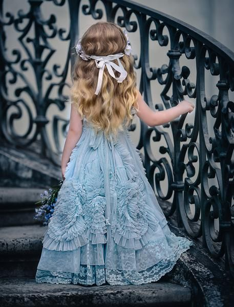 A beautiful design withheavily gathered swirls for all the girls that love to twirl. This light blue colour way has a beautiful braid on the bodice andwide la