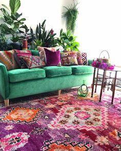 Interior Design | Home Decor | Living Room | Printed Carpet | Green Sofa | Indoor Plants