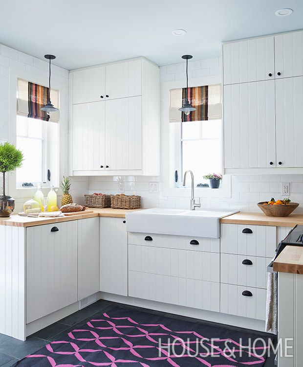 Bright window treatments and a playful rug invigorate the white interior. | Photographer: Ashley Capp Designer: Sarah Hartill