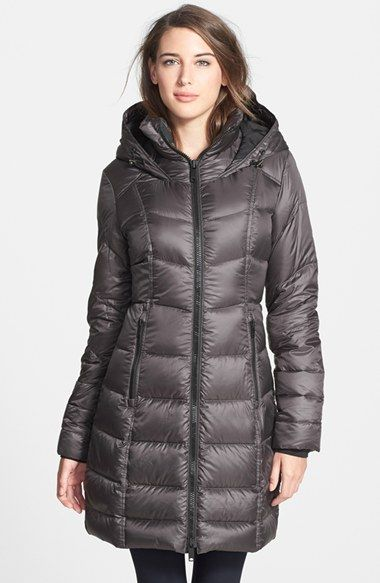 Free shipping and returns on Zella 'Snow Drift' Quilted Down Parka at Nordstrom.com. A cold-weather coat packed with toasty-warm down offers extra protection with a stand collar surrounded by an adjustable hood. The long silhouette strikes a feminine note with contoured vertical seams drawing in the waist for an hourglass shape.