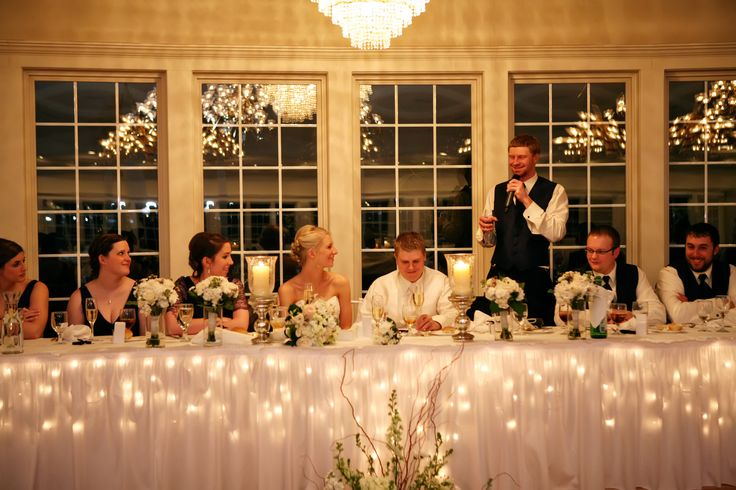 The head table at a winter wedding reception. Balderston Photography at the Hawthorne House Wedding Venue