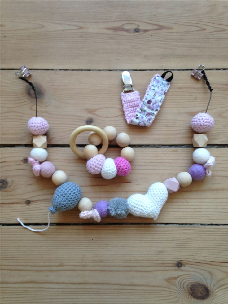 Pretty string for the baby carriage, a pacifier string and a rattle  - Made by Mikie hjelm