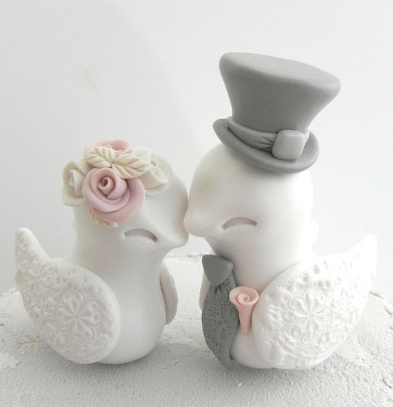 I hand sculpted these adorable little birds from polymer clay. This is a wonderful totally handmade piece for your most special day. If you love these birds, but you need a different color, you can either provide a shade color, or a photograph with the color you want and I will match it as close as possible.