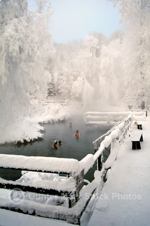 People soaking in Snow Covered Liard Hot Springs in Liard River Hot Springs Provincial Park, Northern British Columbia, Canada, in Winter – A. Rene