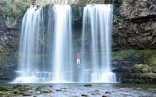 """Sgwd Yr Eira, Wales. One of several spectacular waterfalls found in the Mellte Valley in the Brecon Beacons, Sgwd Yr Eira, meaning """"fall of snow,"""" can be reached from the car park at the Porth yr Ogof cave, where the river disappears underground, or from Pontneddfechan, the nearest village. A track links the two starting points and gives walkers access to five different falls."""