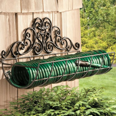 Coiled Garden Hose Holder At SkyMall For $39.97