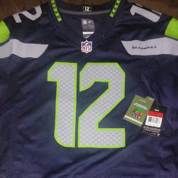 Dropped ⬇ NIKE NFL SEAHAWKS JERSEY SZ L Brand new with tags, just not attached , excellent condition. Never worn Seahawks NIKE NFL official brand Jersey. Size large. Nike Other
