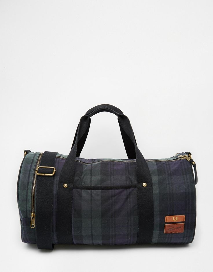 """Barrel bag by Fred Perry Cotton check fabric Twin handles Long shoulder strap Dual zip closure Front pocket Zipped side pocket Quilted interior Wipe clean with a damp cloth 100% Cotton H: 25cm/ 10"""" W: 45cm/ 18"""" D: 25cm/ 10"""""""
